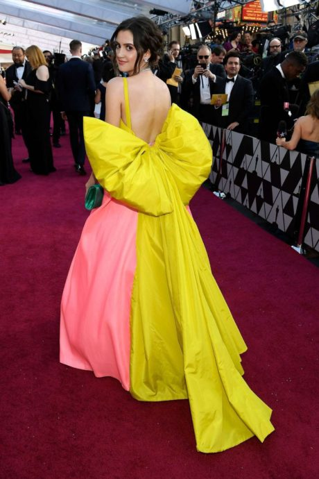 Laura Marano in yellow=pink dress at the Oscars in Los Angeles, 2019