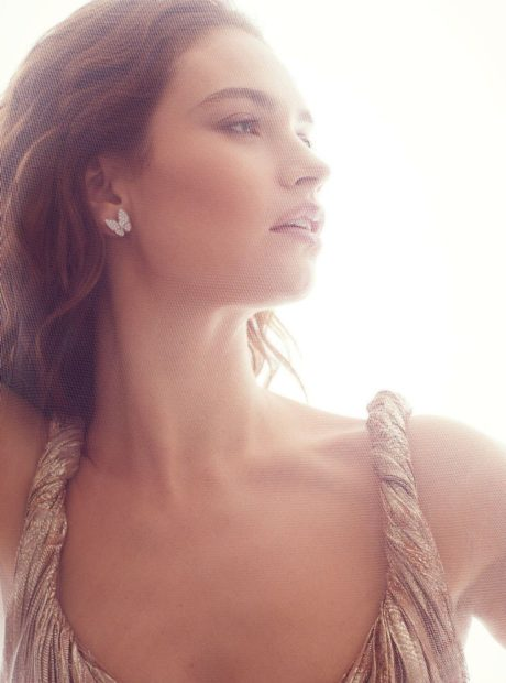 Lily James butterfly earrings for Harpers Bazaar