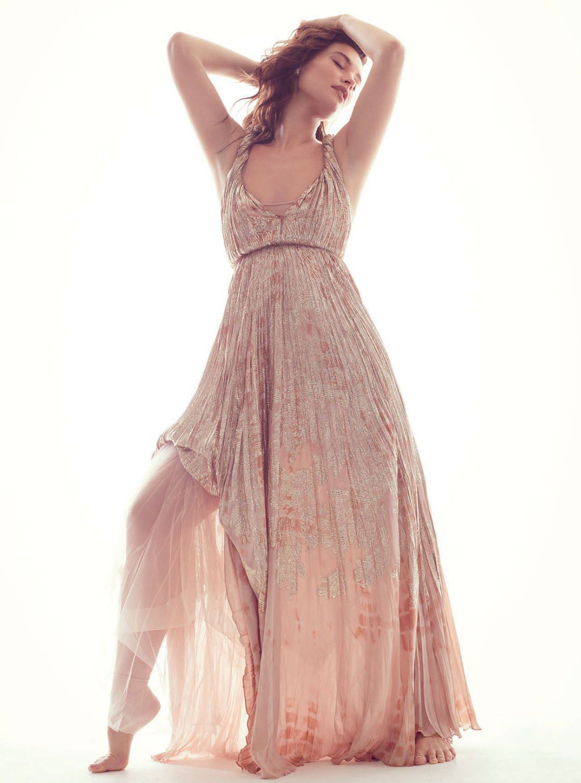 Lily James in ancient dress for Harpers Bazaar
