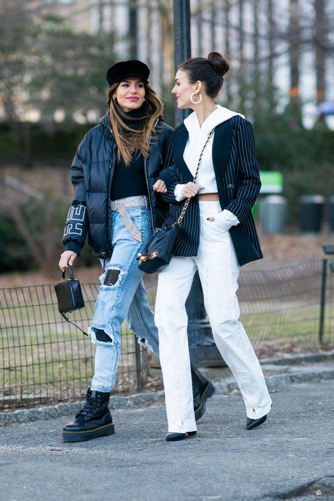 Madison Reed and Victoria Justice are walks by the hand