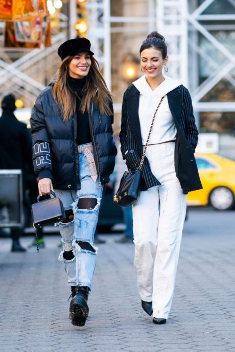 Madison Reed and Victoria Justice with small bags