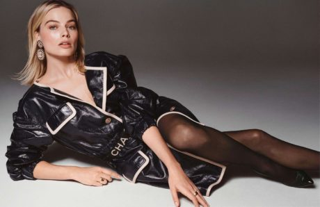 Margot Robbie is lying in leather jacket by chanel for Elle France