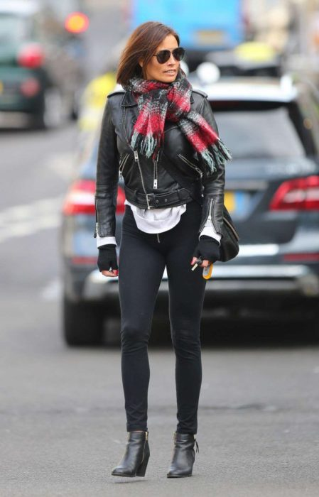 Melanie Sykes in tight black pants, street style, London