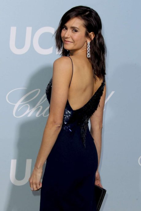 Nina Dobrev in dark blue dress, back view