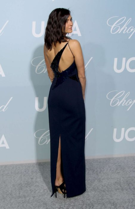 Nina Dobrev in dark blue dress with a cut on the back