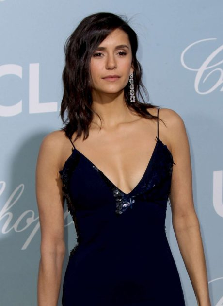 Nina Dobrev in dark blue dress with long earrings