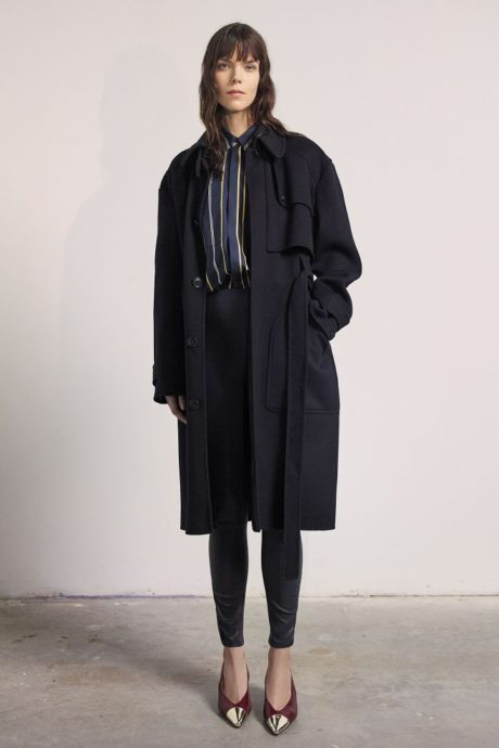 a model in black winter coat by Jason Wu