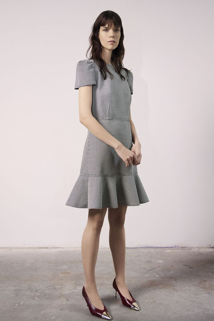 a model in grey dress by Jason Wu