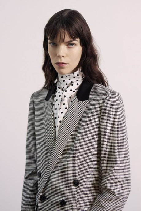 a model in grey office suit by Jason Wu