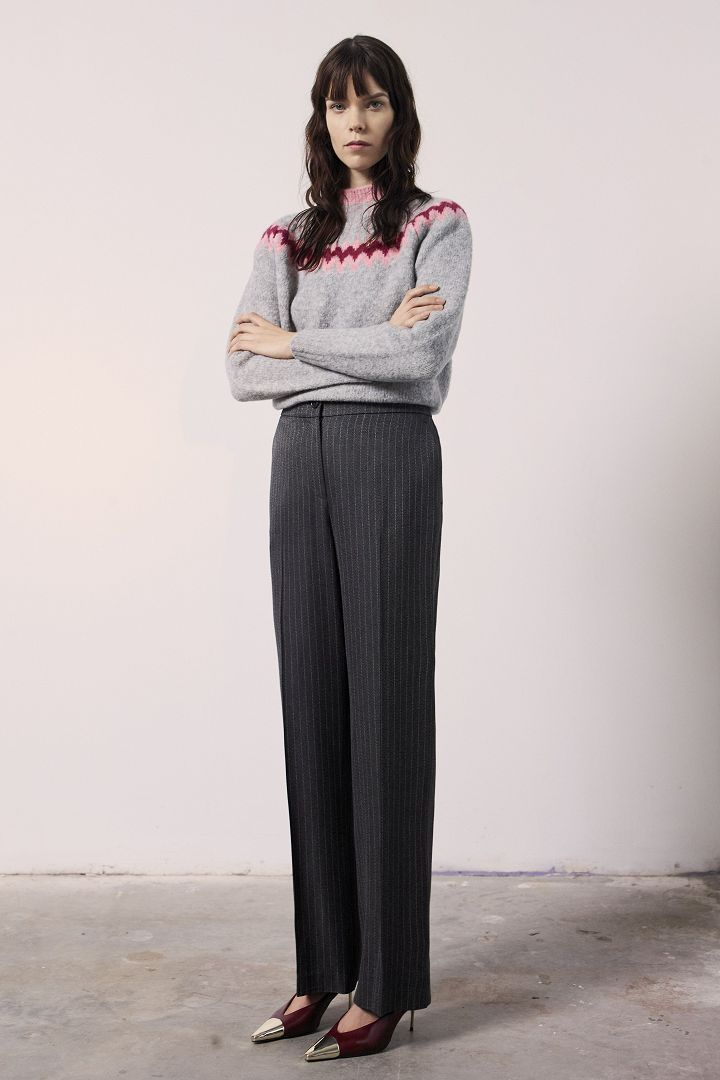 a model in grey pullover and long pants by Jason Wu