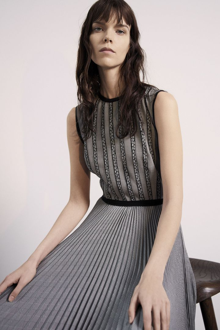 a model in grey stripped dress by Jason Wu