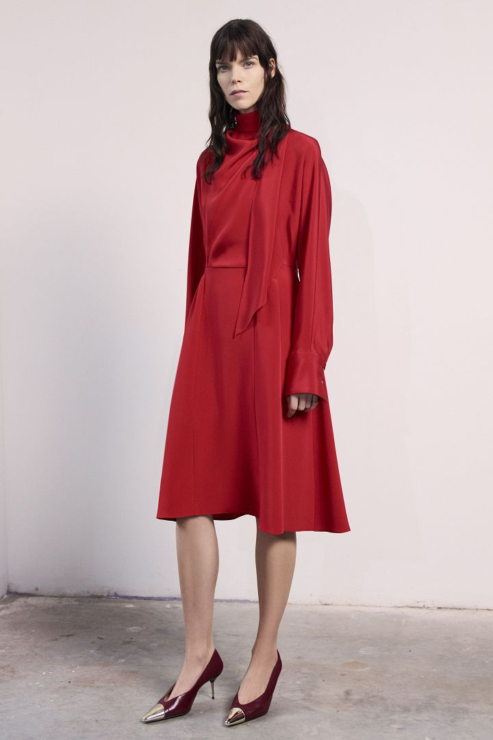 a model in long red dress by Jason Wu