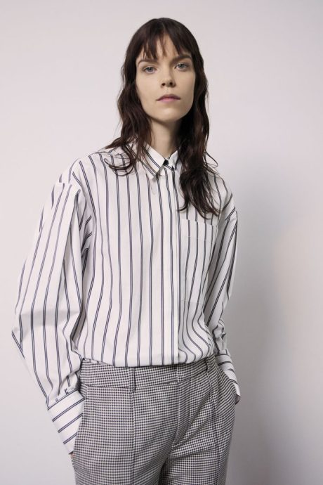 a model in white stripped t shirt by Jason Wu