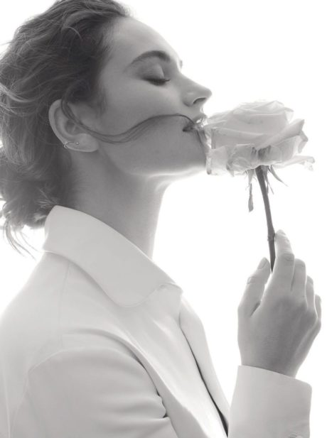 amazing Lily James with white rose for Harpers Bazaar