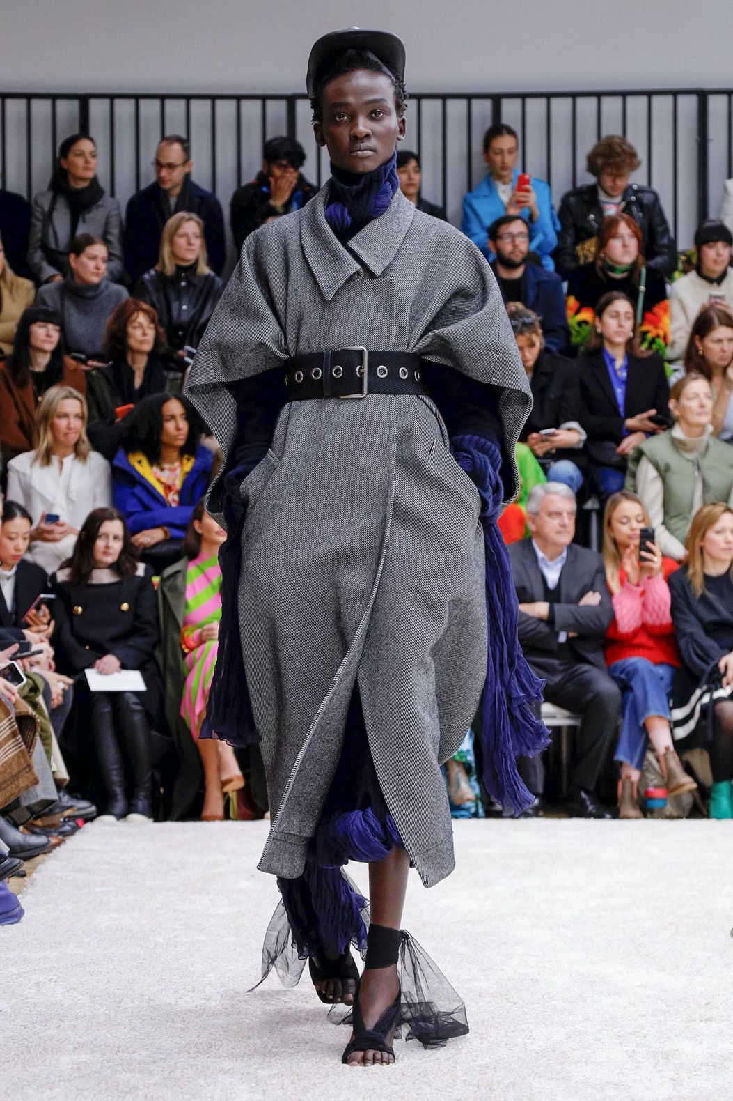 black model in dark grey coat and black belt by JW Anderson
