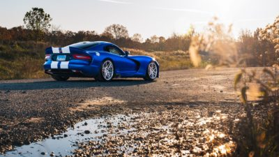blue Dodge Viper at sunset