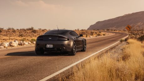 dark grey Aston Martin at road