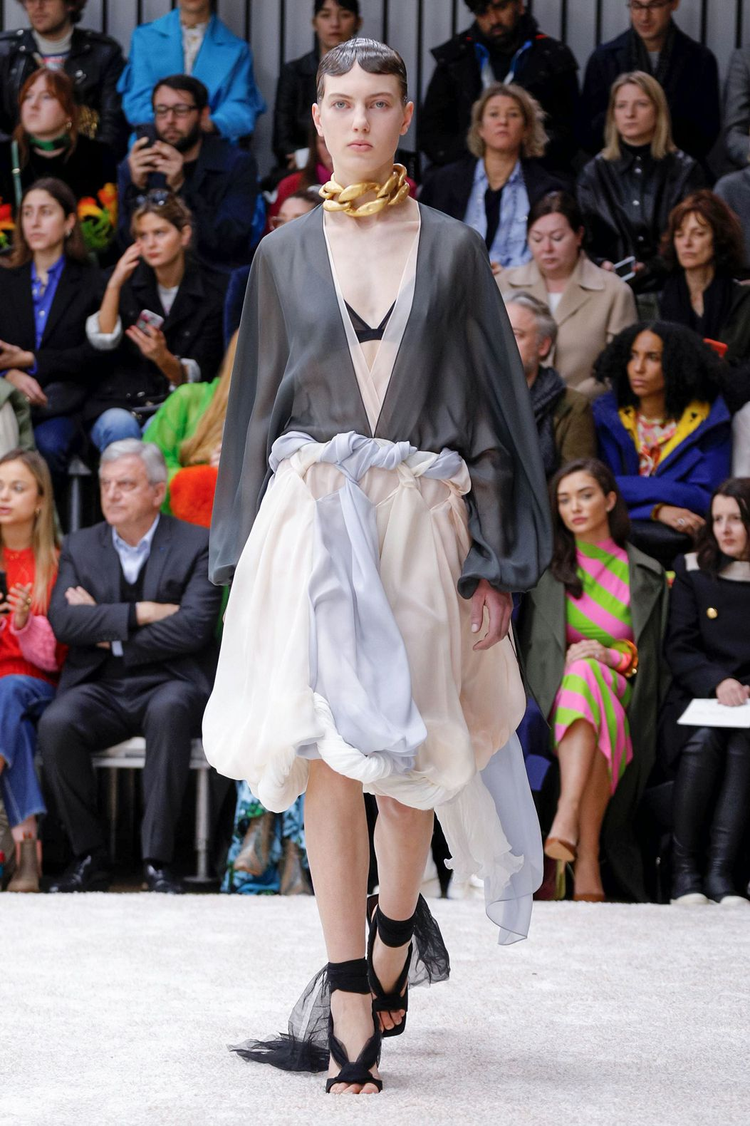 golden neckband and dreess with neckline by JW Anderson