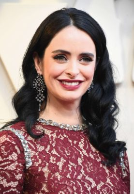 Photo 06: happy Krysten Ritter in red dress at the Oscars in Los Angeles, 2019
