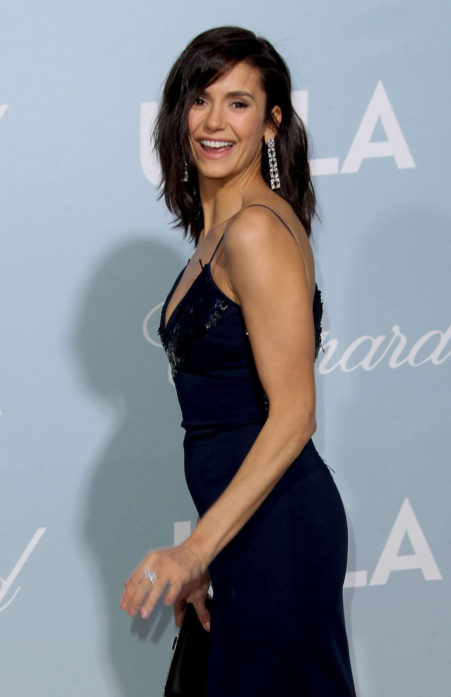 happy Nina Dobrev in dark blue dress