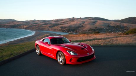 red Dodge Viper SRT near a ocean