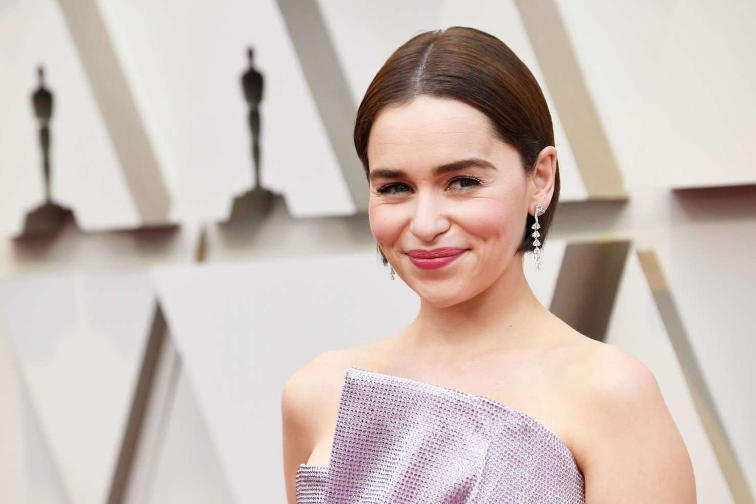 smiles Emilia Clarke at the Oscars in Los Angeles, 2019