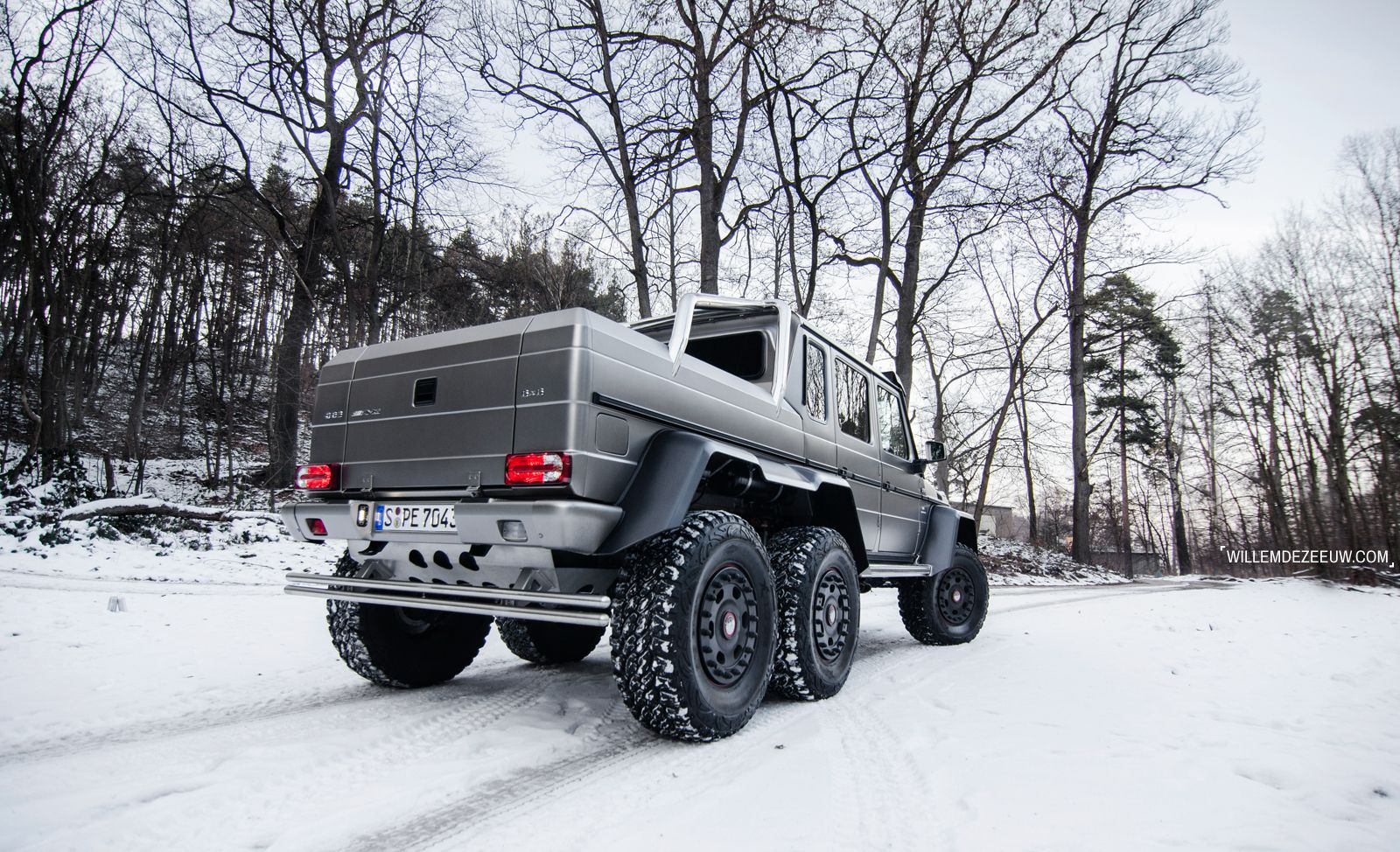 the Mercedes-Benz G63 AMG 6x6 in winter, around the forest