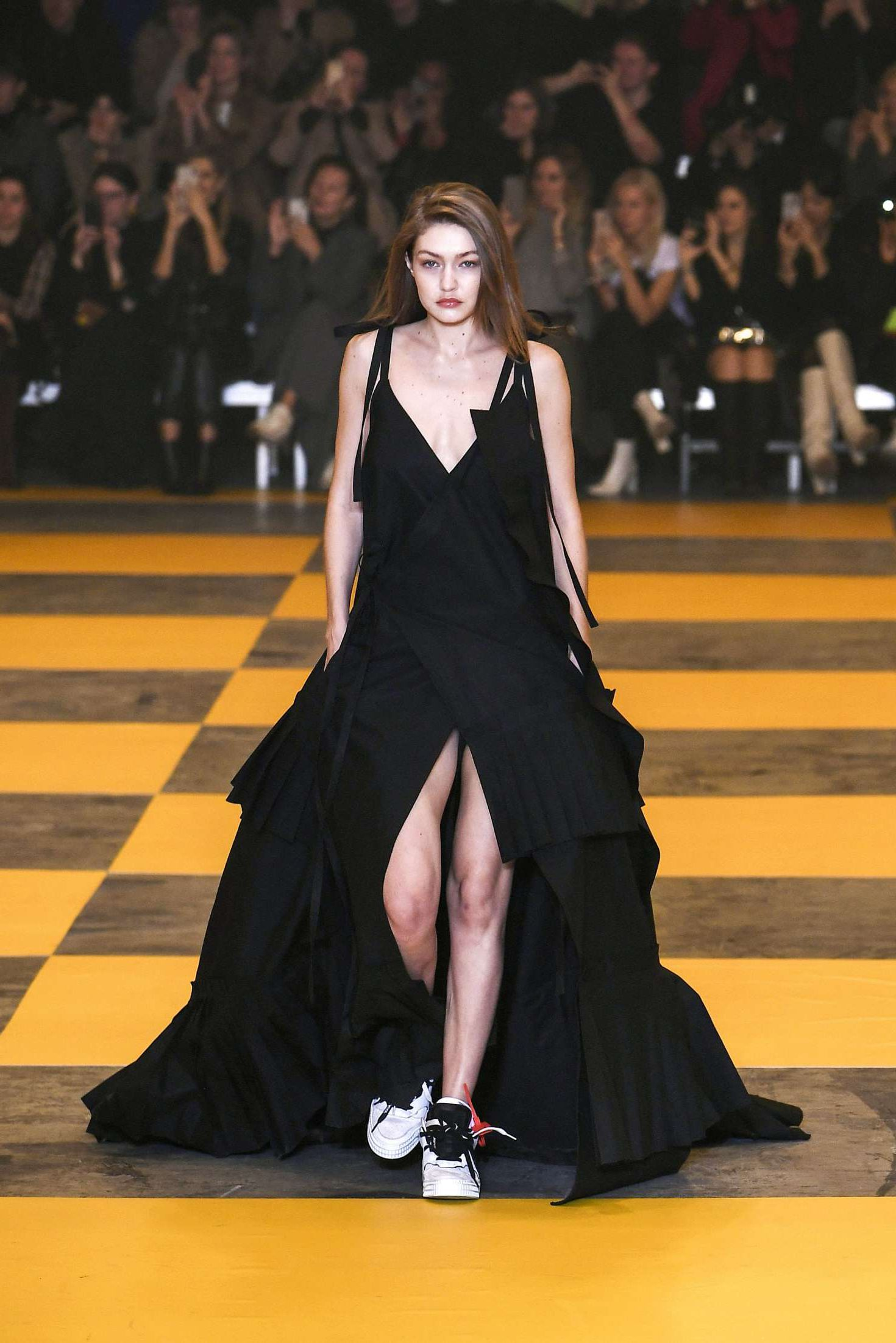 Gigi Hadid in beautiful black dress at the Off-White Women's Runway Show in Paris, 2019