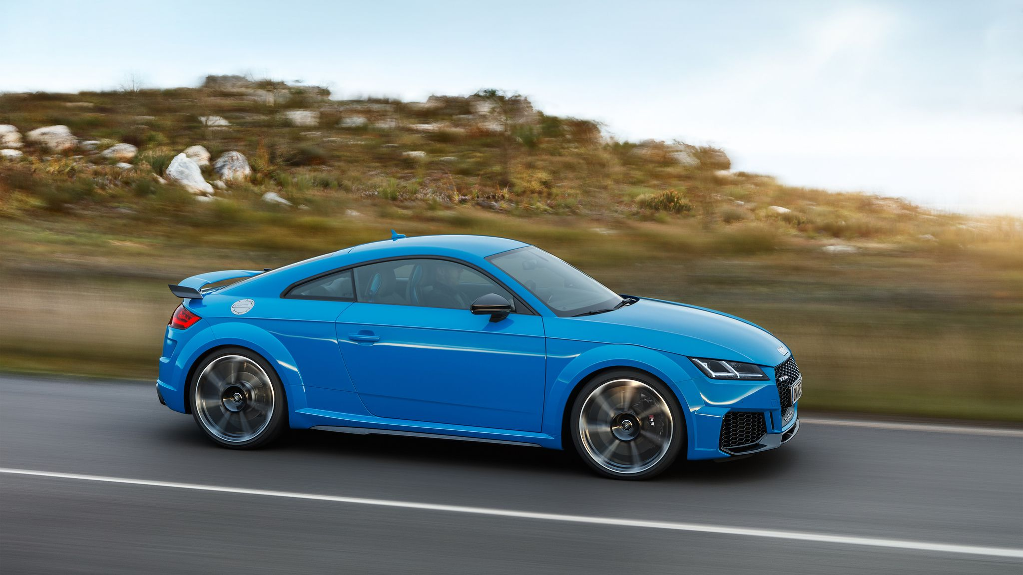 TT RS Coupé - side view, in motion