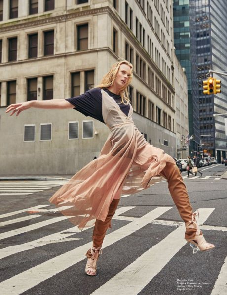 Anne Vyalitsyna in Dior clothes walks at a city