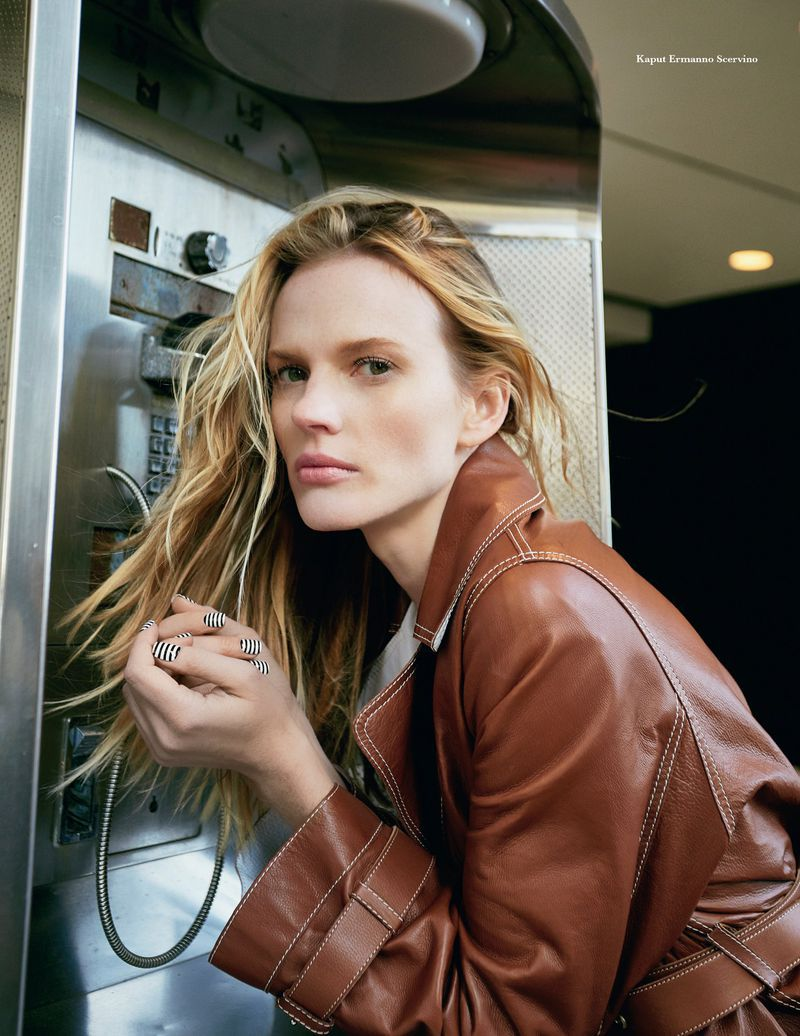 Anne Vyalitsyna in brown leather jacket