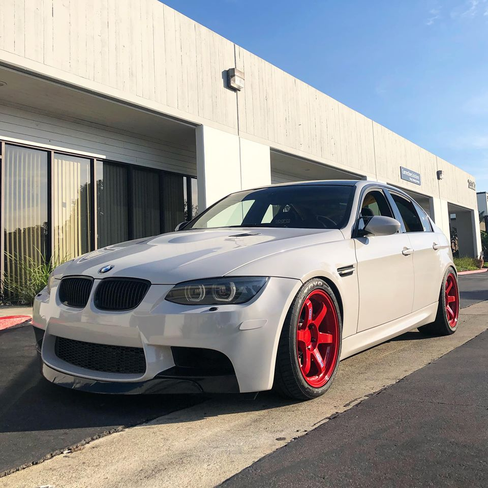 BMW E90 M3 in white colour and red wheels