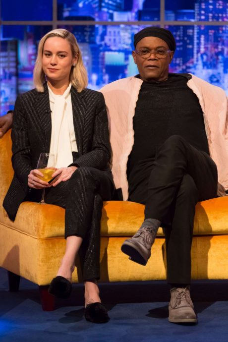 Brie Larson in stylish suit and Jonathan Ross