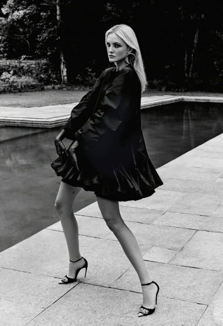 Caroline Trentini in black short dress near swim pool