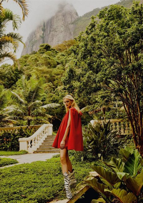 Caroline Trentini in red short dress at green place background