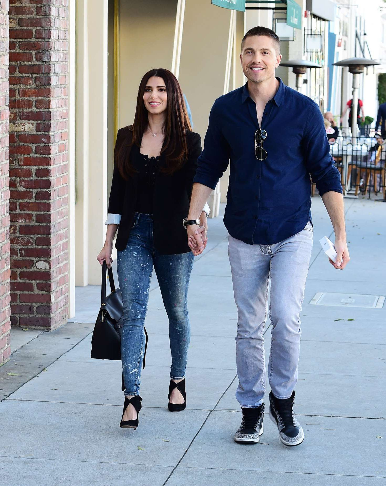 Eric Winter in blue t shirt with Roselyn Sanchez