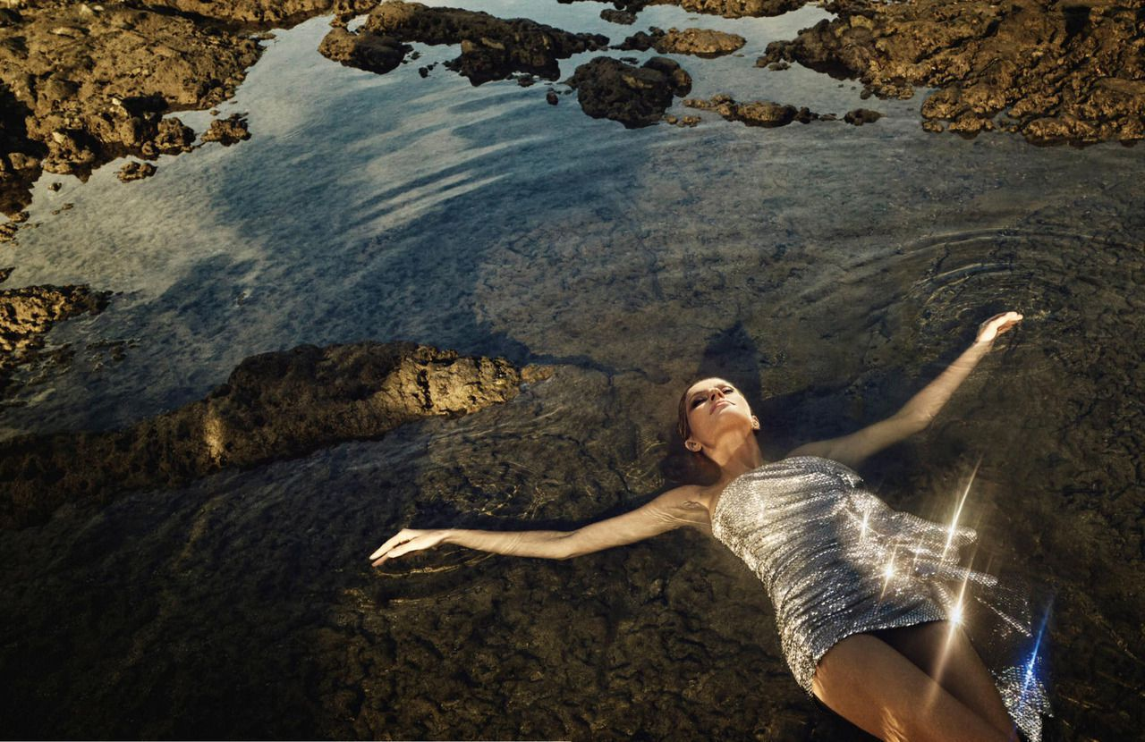 Gisele Bundchen lies on her back in water