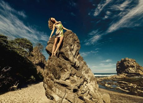 Gisele Bundchen on the peak of a rock
