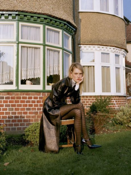 Harleth sits in black leather jacket