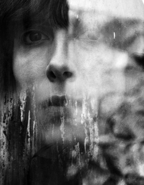 Jamie Bochert - face reflecton on a glass