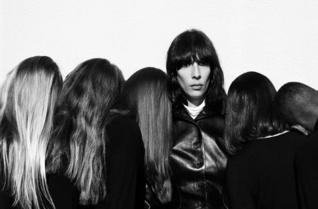 Jamie Bochert in black&white around other heads