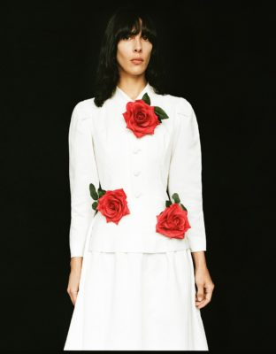 Jamie Bochert in white dress with red roses