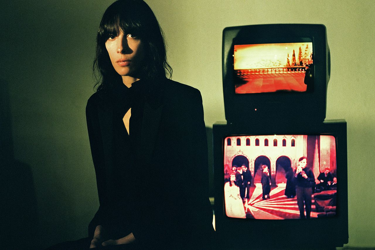 Jamie Bochert near with older TV