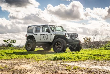 Jeep Wrangler JLU Rubicon at green field