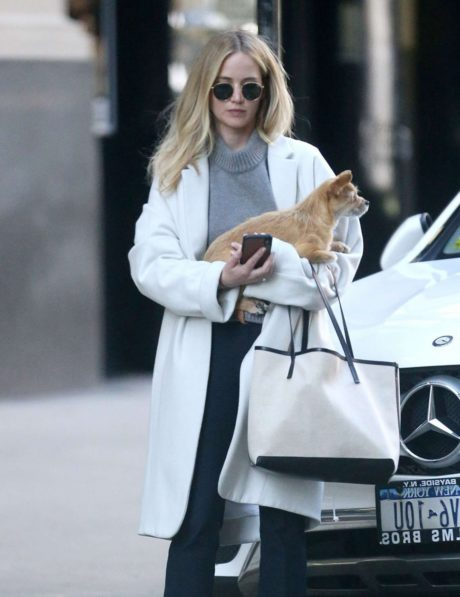 Jennifer Lawrence in white coat near at mercedes