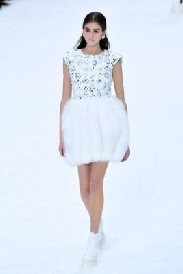 Kaia Gerber in white dress at the Chanel Runway Show, 2019
