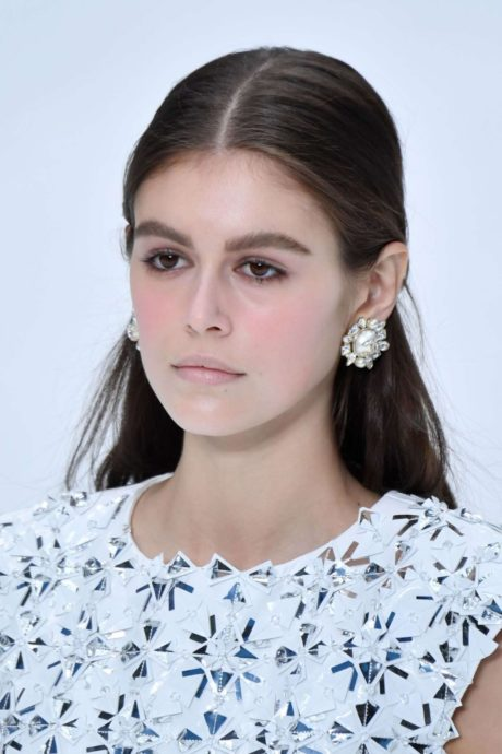 Kaia Gerber with brilliant earrings at the Chanel Runway Show, 2019