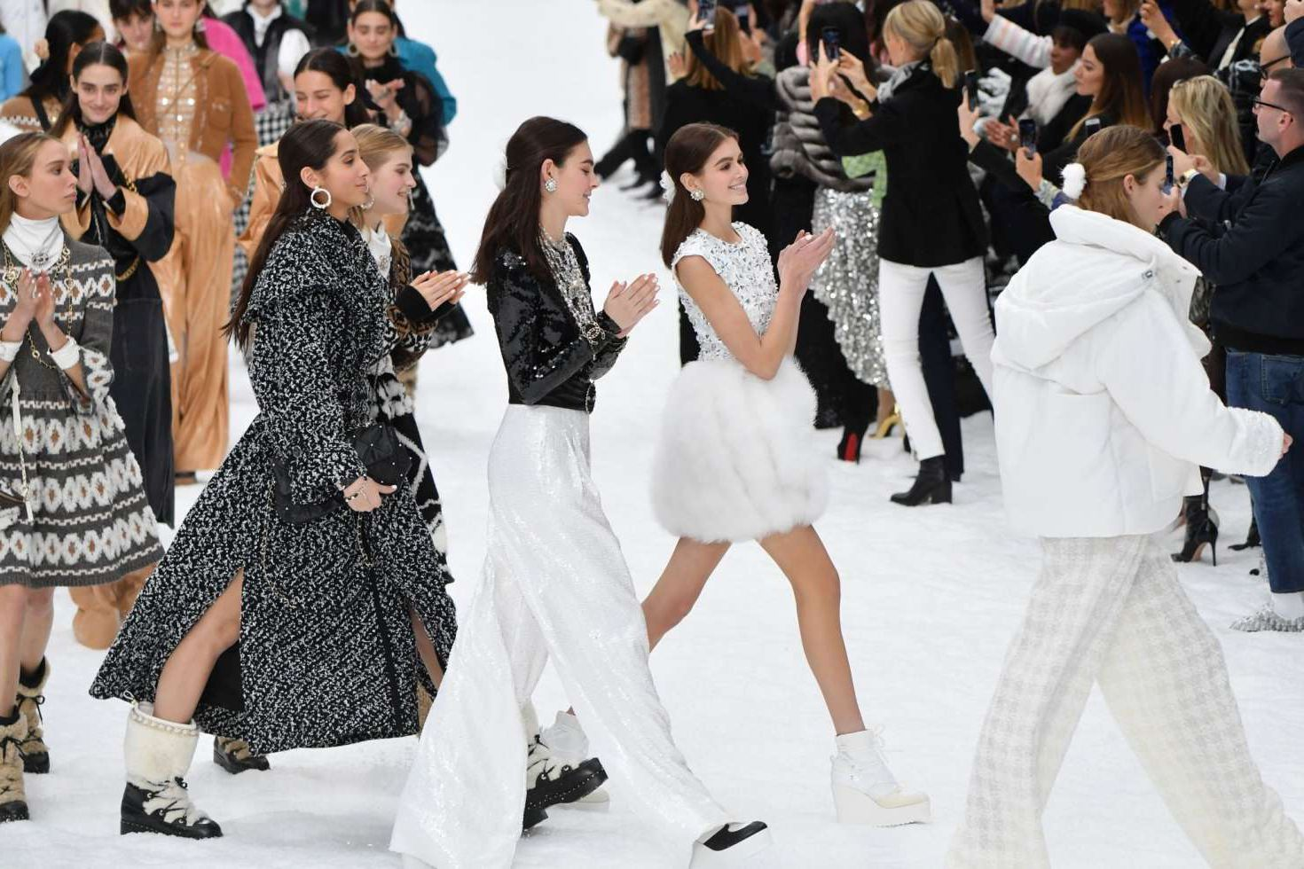 Kaia Gerber with other models at the Chanel Runway Show, 2019
