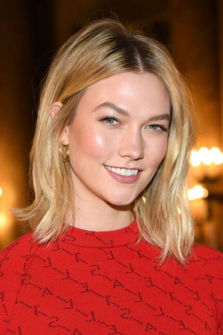 Karlie Kloss in red long dress at the Stella McCartney Fashion Show in Paris, March 2019