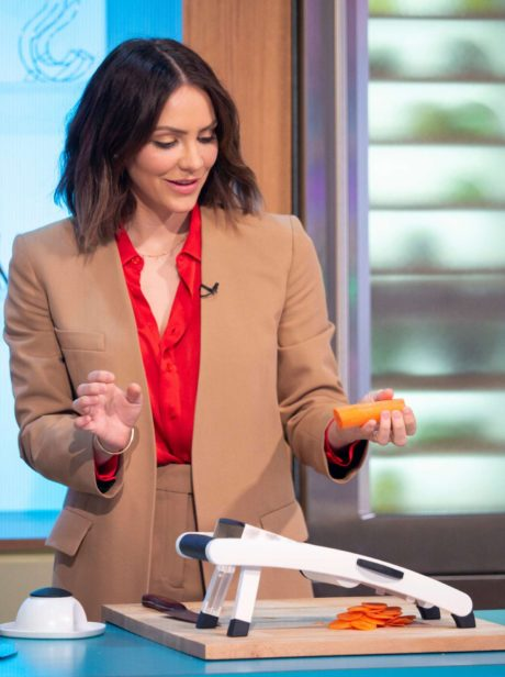 Katharine McPhee holds a carrot at the Sunday Brunch Show in London, 2019
